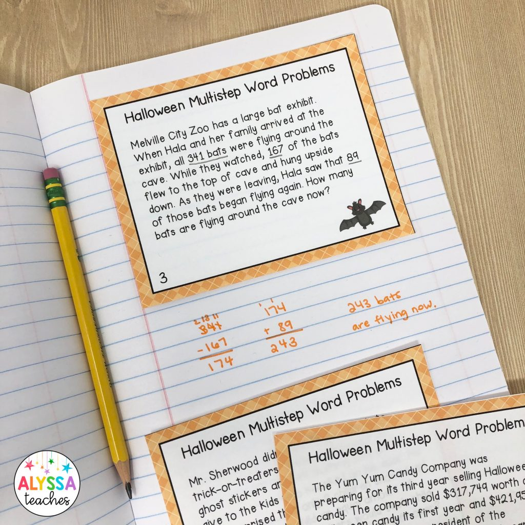 math notebook with Halloween-themed 2-step word problem task card